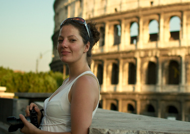 Daniela with her camera in front of the Colosseum in Rome, Italy